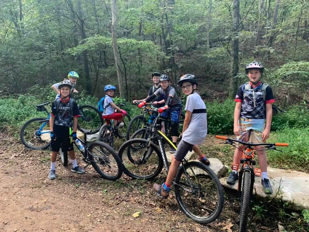Cycling team on trail